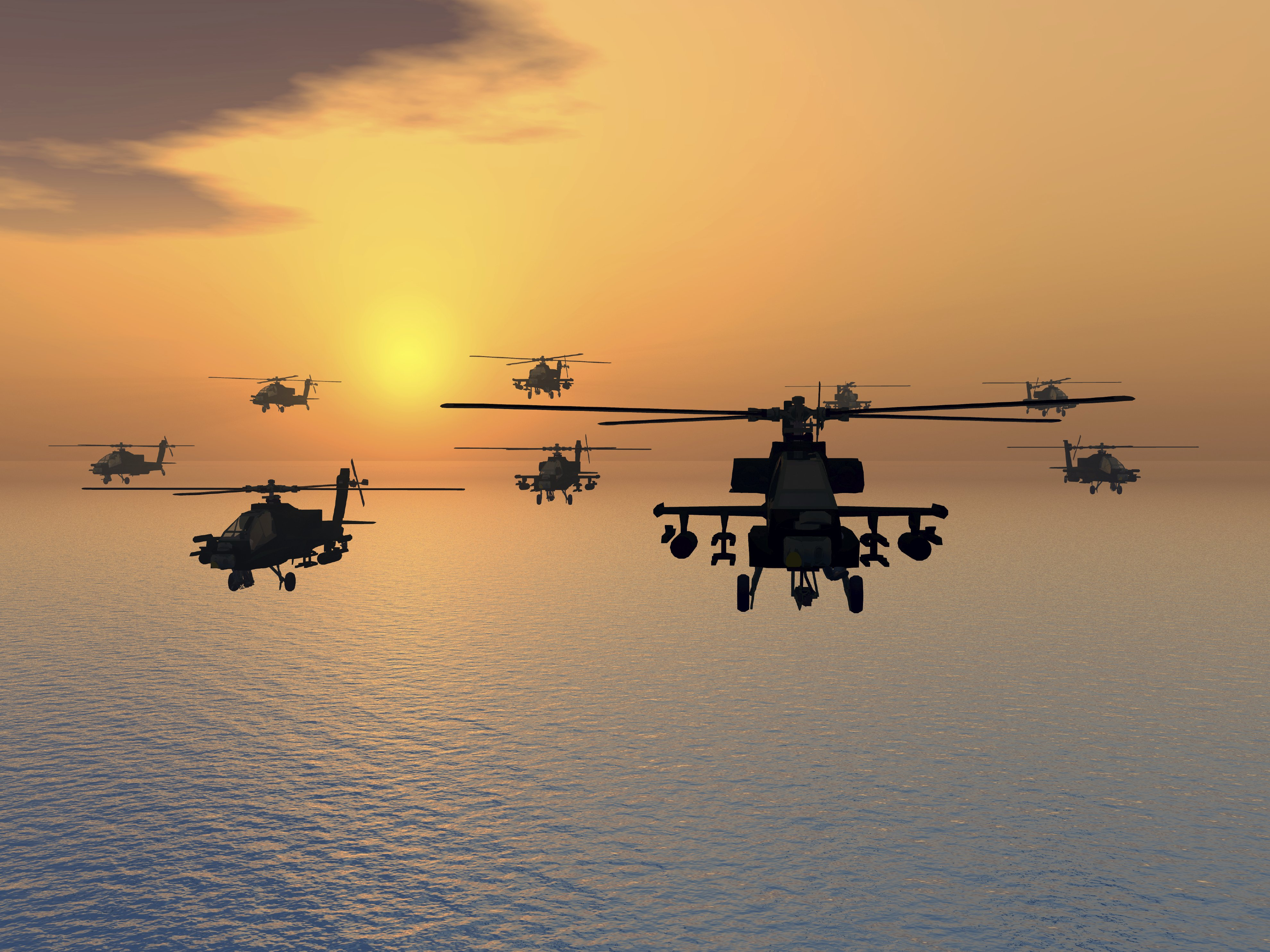 Photo of a helicopter fleet over the ocean at sunset