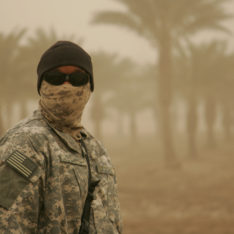 Photo of a soldier with a protective face mask in a sand storm