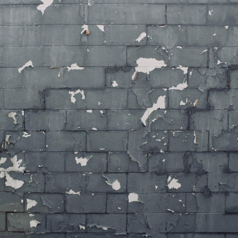 Photo of an old, grey brick wall