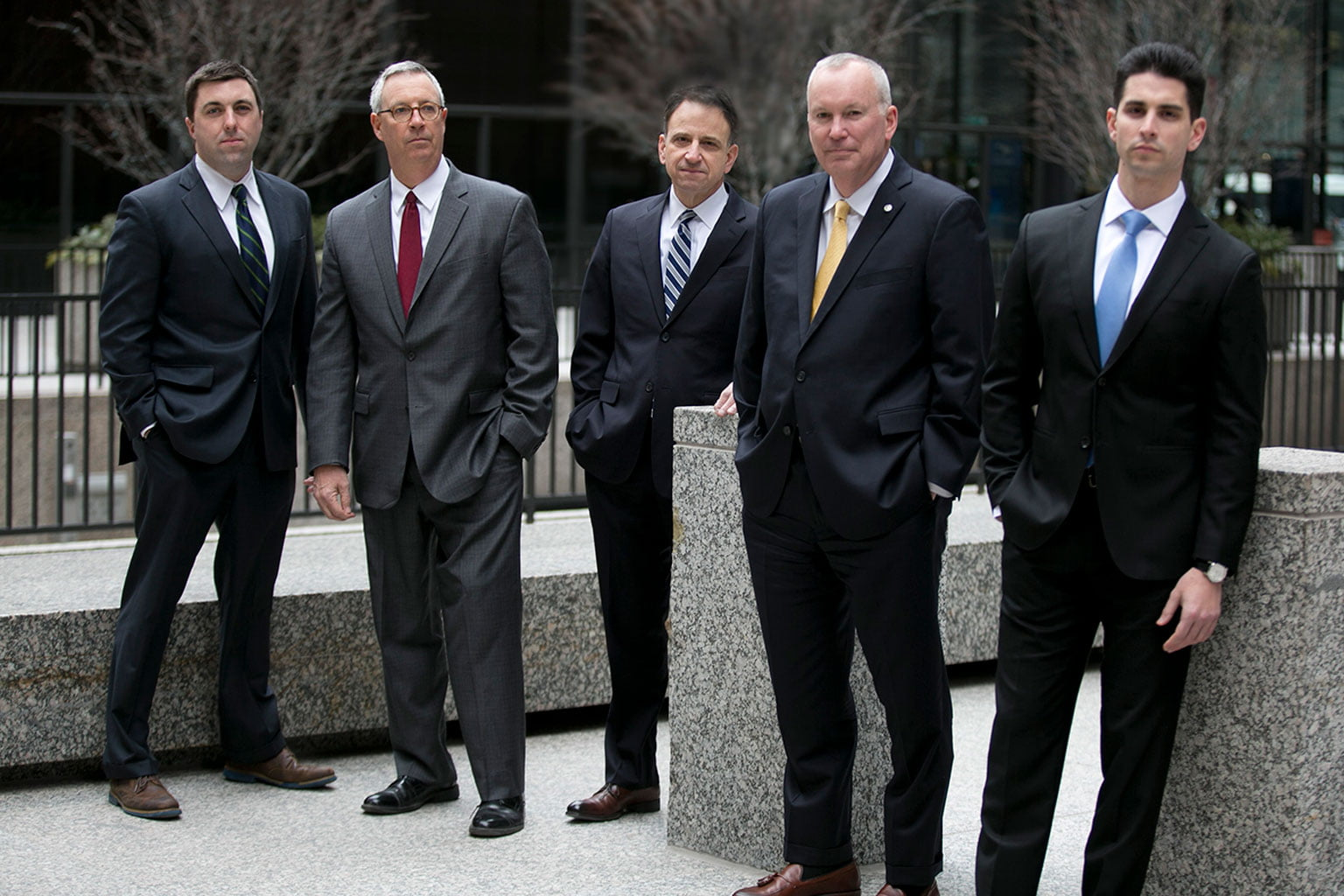 Photo of the attorneys for Capron Avgerinos outside of their office.