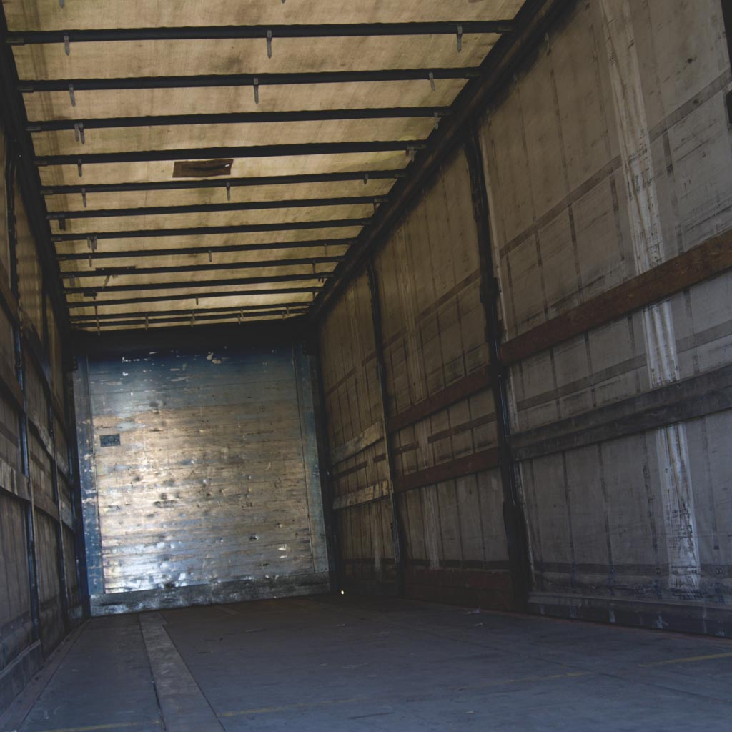Photo of an empty semi truck trailer from an odd angle